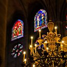 Chandelier and stained glass - Notre Dame Cathedral Paris France by Norman Repacholi