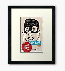 A thief Framed Print