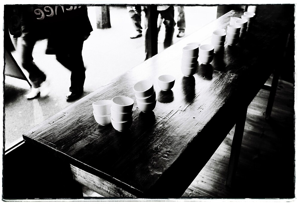 Bowls on wooden table as the crowds pass by Brett Squires