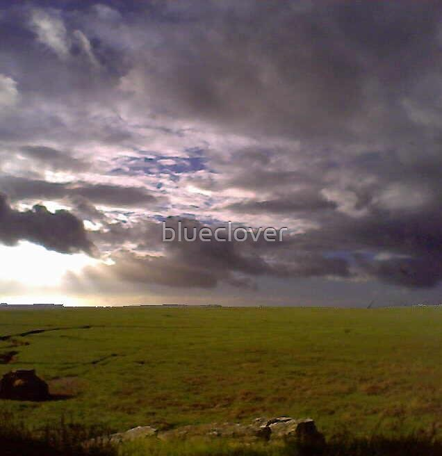 Cloudy Sky hovers over green Morecambe Bay by blueclover