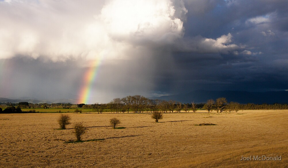Rainbow storm by Joel McDonald