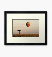 Dawn flight over the Masai Mara Framed Print