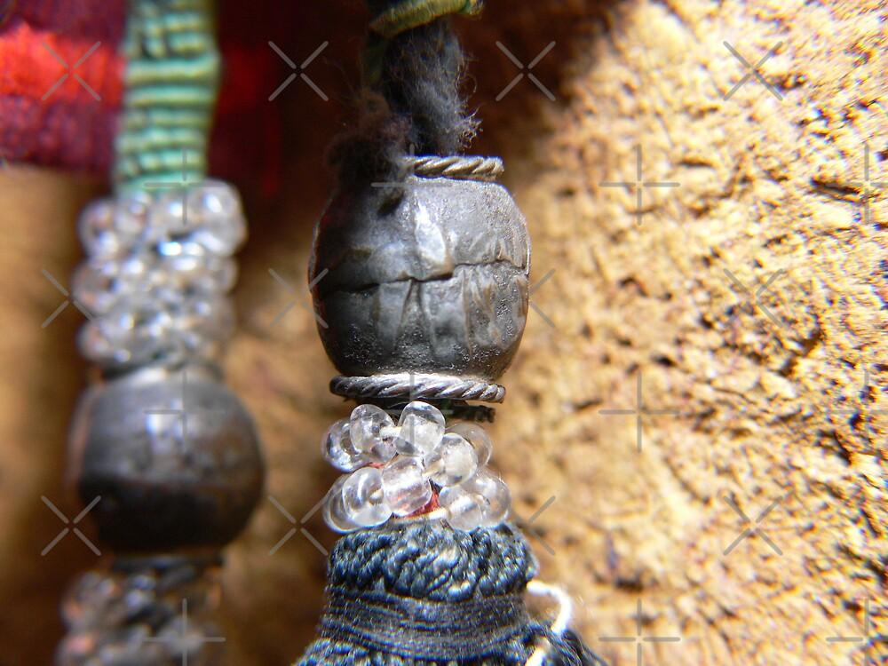 Silver bead on handwoven tassel by Sandra Chung