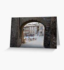 Stone arch through a public square in Assisi, Italy. Greeting Card