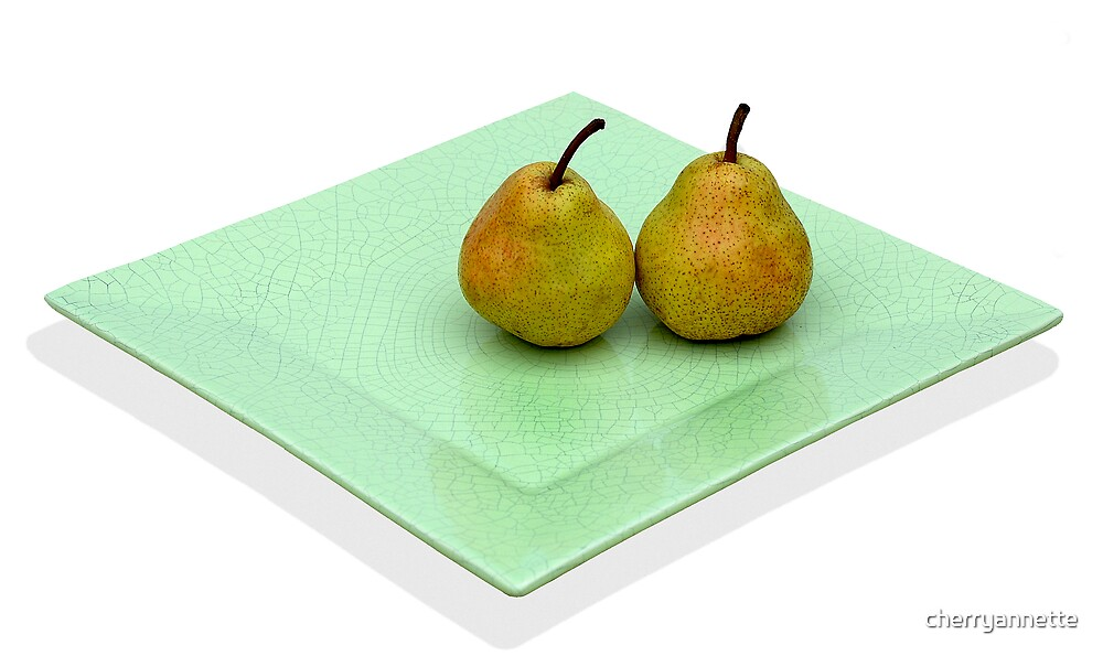 pears on a green plate by cherryannette