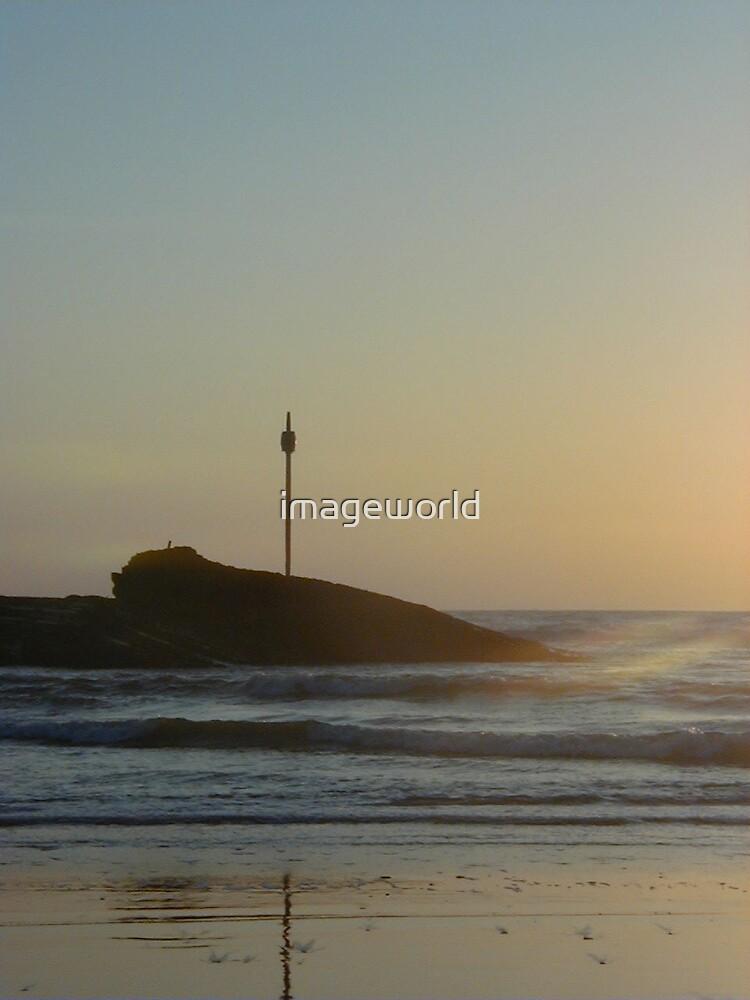 Barrel rock at sunset by imageworld