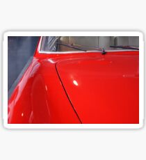 Front detail of vintage red car with shining hood  Sticker