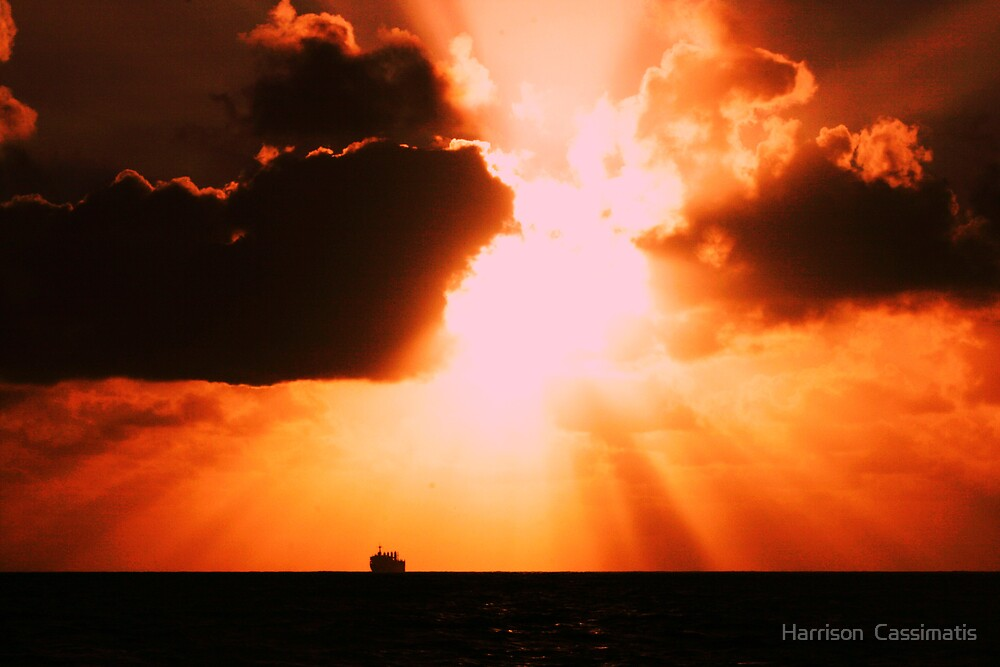 sunset with a bulk tanker on the horizon by Harrison  Cassimatis
