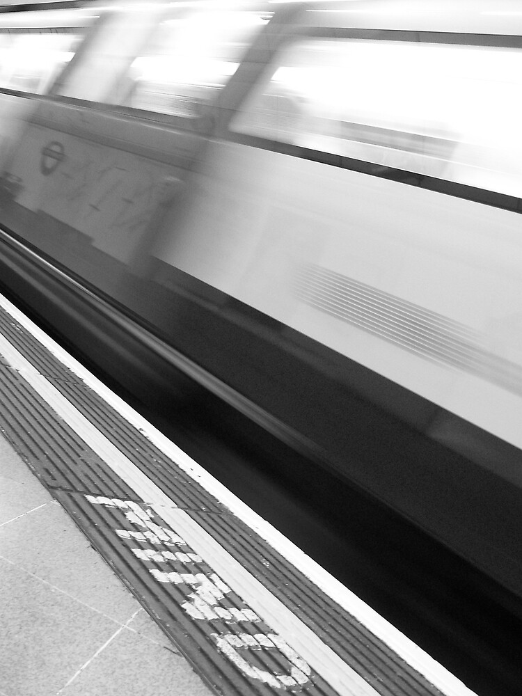 train in motion by Sam Everitt
