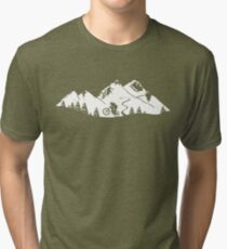 Wheelie in front of mountains Tri-blend T-Shirt