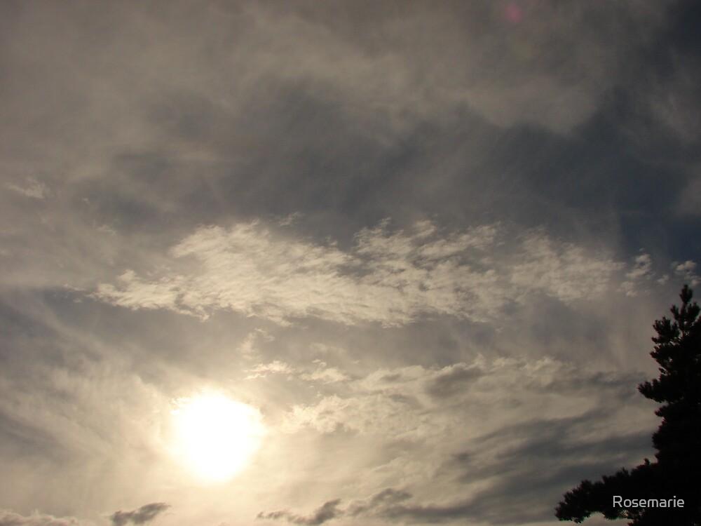 sun in clouds by Rosemarie