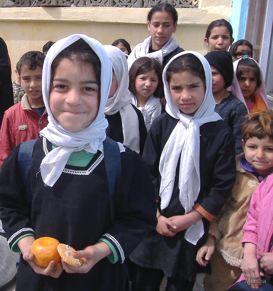 Afghan students thrilled to have an orange and cookie by Marsha