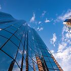 Office building and sky by Bradley Hebdon