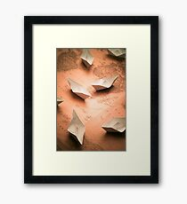 Small paper boats on top of old map Framed Print