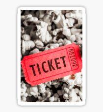 Event ticket lying on pile of popcorn Sticker