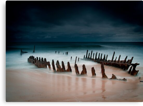 A beach with water by Mark Braham