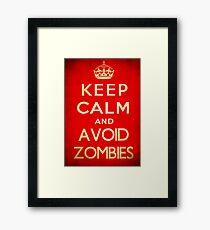 Keep calm and avoid zombies. Framed Print