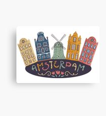 Amsterdam. Old historic buildings and traditional architecture of Netherlands. Windmill and houses with hand drawn lettering. Canvas Print