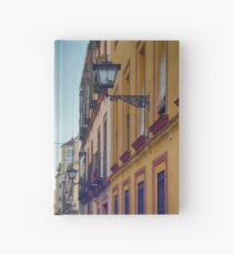 Colorful buildings on a street from Sevilla, Spain Hardcover Journal