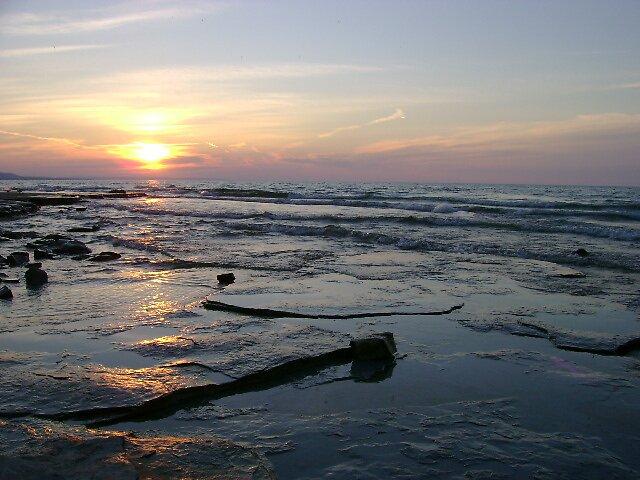 Sunset on the beach by Robert Lake