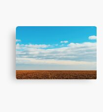 Cloudy Sky Over Harvested Land In Autumn Canvas Print