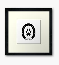 Horse shoe and canine paw print Framed Print