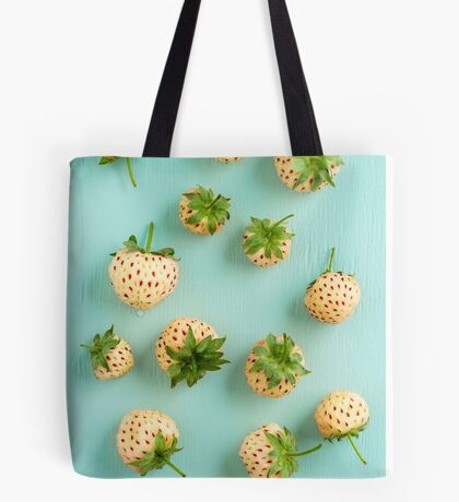 Fresh pineberries on turquoise Tote Bag