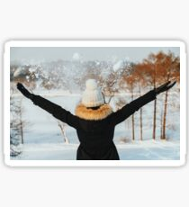 Girl Throwing Snow In Air During Winter Sticker