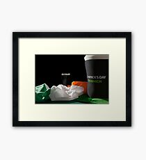 St Patrick day with a pint of black beer, hat and irish flag over a green table Framed Print