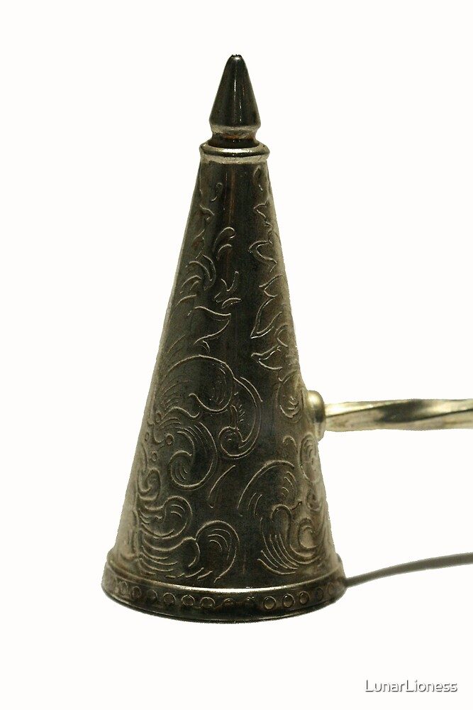 Ornate candle snuffer - macro by LunarLioness