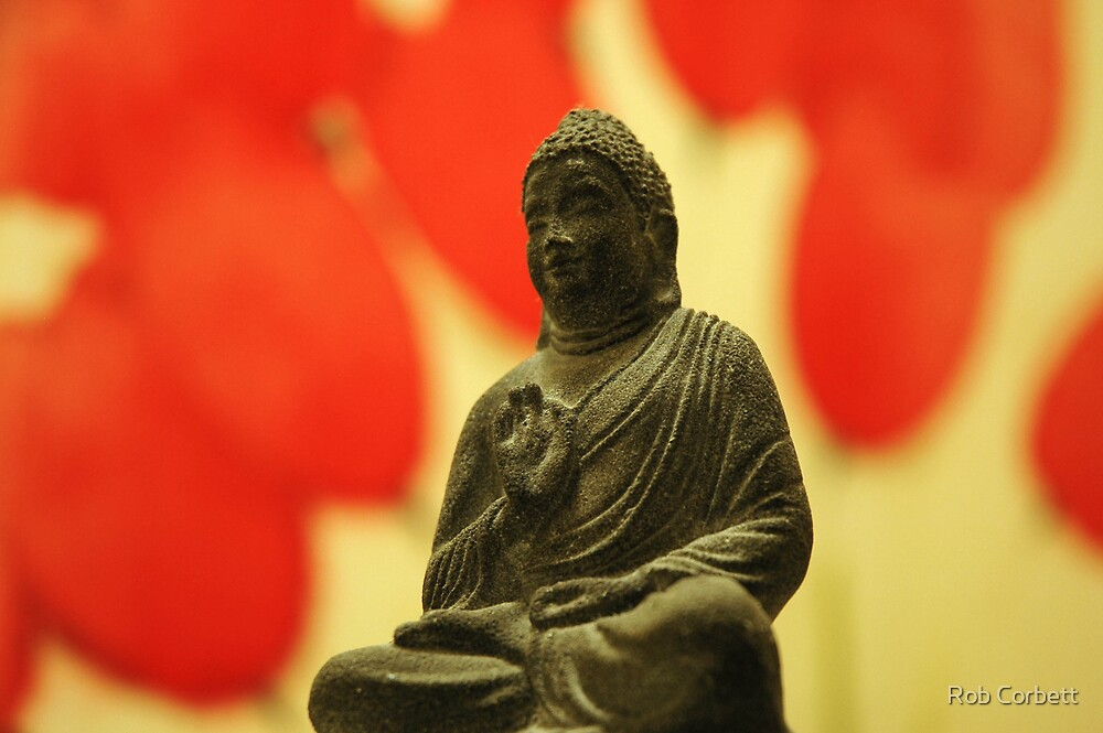 Buddha, with red flowers by Rob Corbett