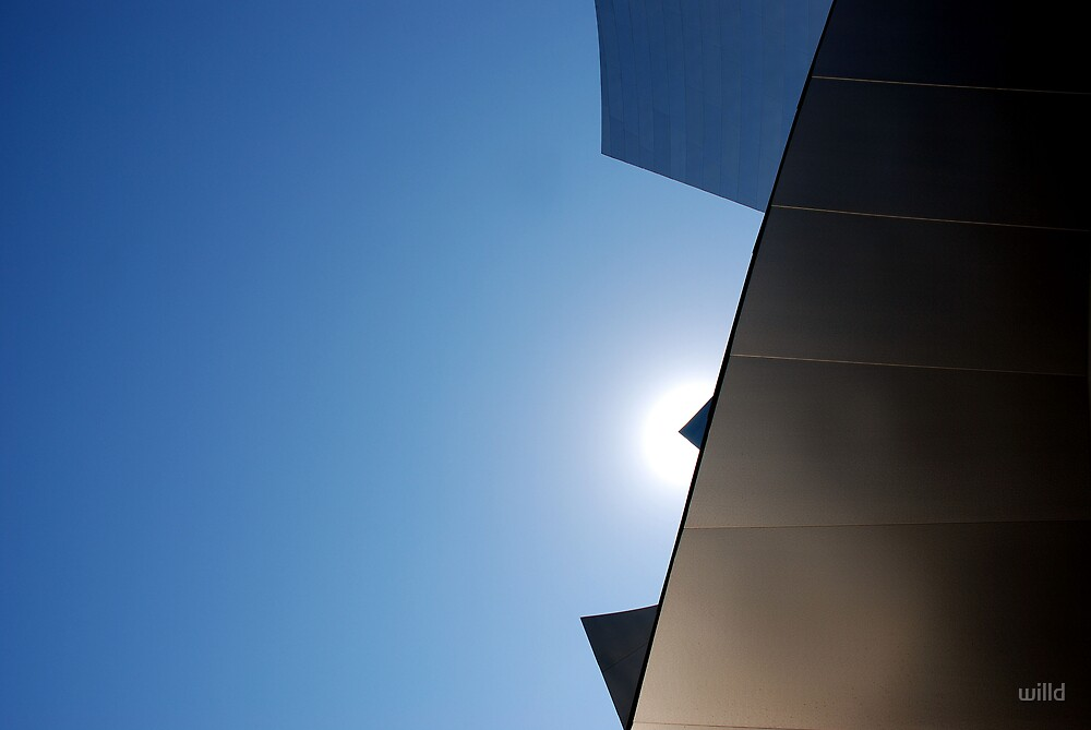 sun over roof top by willd