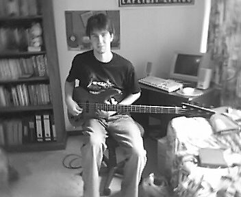 my son and his guitar by TeeAy