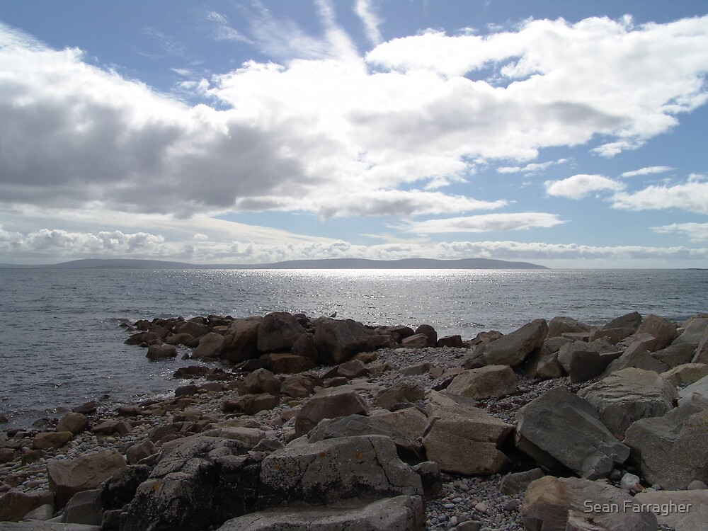 blue sky rocks by Sean Farragher