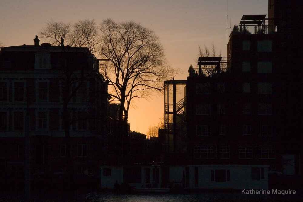 Sunset over Amsterdam city's skyline by Katherine Maguire