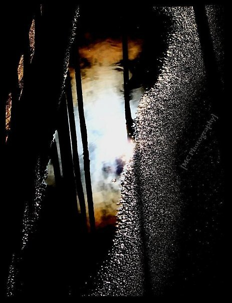 Sky's reflection by Melissa  Carroll