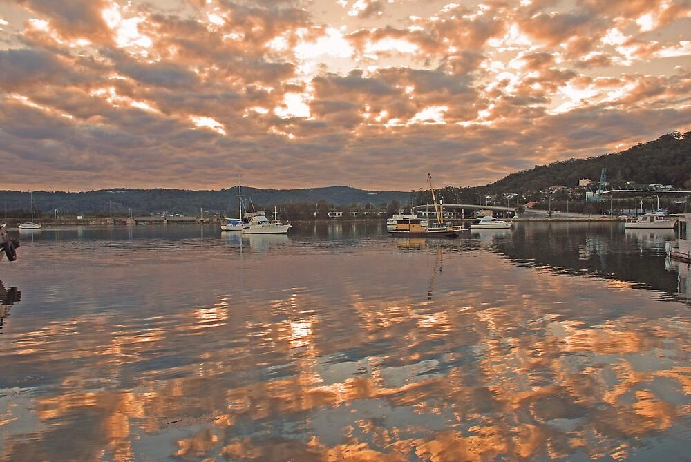 Sunset reflections by Chris  O'Mara