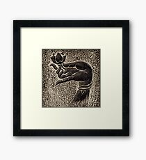 Buddha hand with a lotus art photo print Framed Print