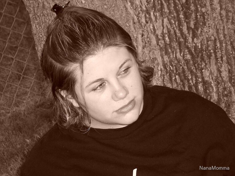 Ashley Sitting by a tree by NanaMomma