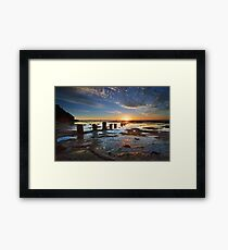 Sunrise, Reflections and silhouettes coastal rockshelf Framed Print