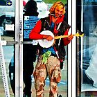Street Musician - A One Man Band by AspenWillow