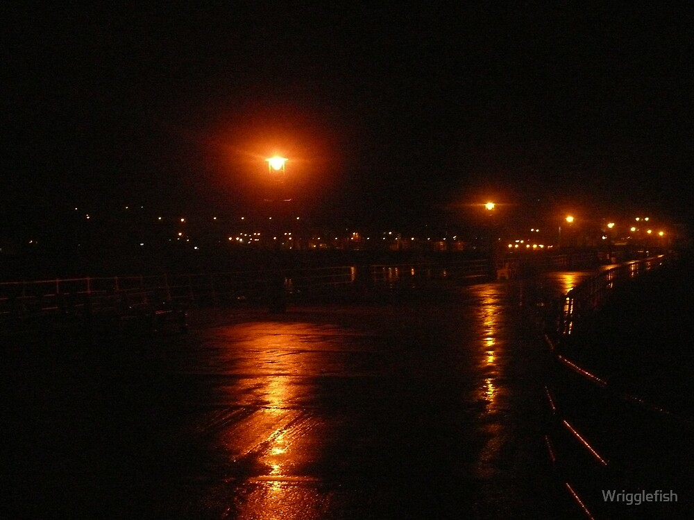 whitby pier by night by Wrigglefish