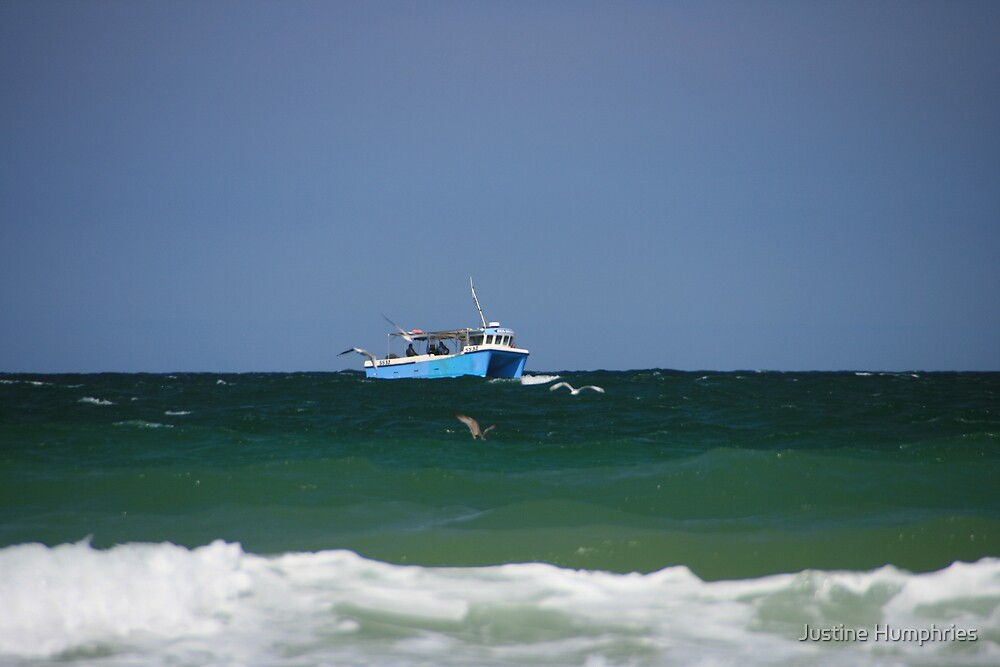 Boat at sea by Justine Humphries