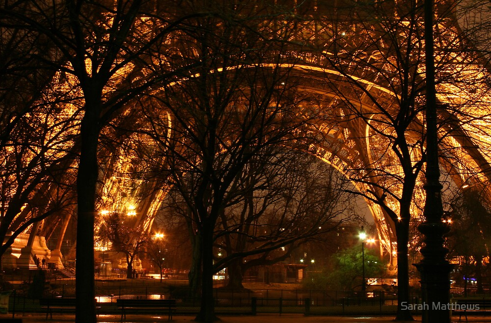 At the Legs of the Eiffel Tower by Sarah Matthews