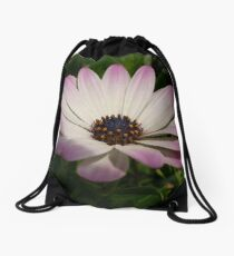 Side View of A Pink and White Osteospermum Drawstring Bag