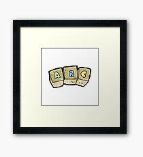 cartoon letter blocks Framed Print
