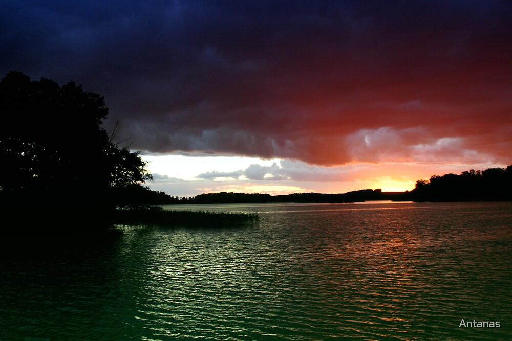 Sunset in lake by Antanas
