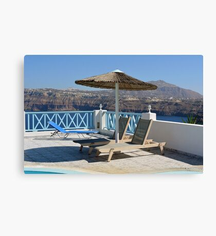 Luxury swimming pool and deck chair at the resort with beautiful sea view Canvas Print