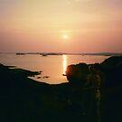 North Sea rocks in setting sun by HELUA