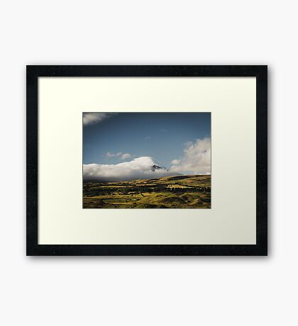 Cotopaxi volcano covered by clouds. Framed Print